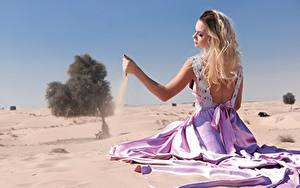 Pictures Sand Blonde girl Frock Sit Beaches Hands