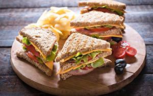 Fotos Sandwich Fast food Brot Oliven Gemüse Schneidebrett