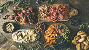 Bilder Wurst Schinken Käse Oliven Butterbrot Brötchen Weintraube Marille Nussfrüchte Obst Schneidebrett