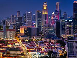 Bilder Singapur Gebäude Wolkenkratzer Abend