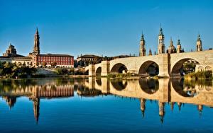 Desktop hintergrundbilder Spanien Flusse Brücke Kathedrale Spiegelung Spiegelbild Turm Zaragoza, river Ebro Städte