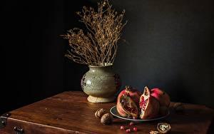 Fotos Stillleben Schalenobst Granatapfel Teller Vase