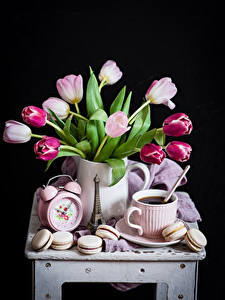 Photo Still-life Tulips Clock Coffee Black background Cup Macaron Flowers