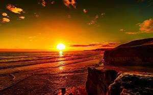 Hintergrundbilder Sonnenaufgänge und Sonnenuntergänge Meer Küste Himmel Sonne Horizont Felsen Natur