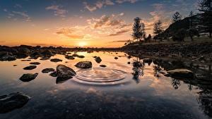 Bilder Sonnenaufgänge und Sonnenuntergänge Steine Wasser Landschaftsfotografie Bäume