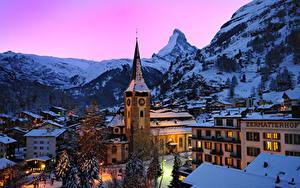 Image Switzerland Houses Mountains Winter Spruce Snow Night time Alps Zermatt Swiss Alps Cities