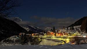 Bilder Schweiz Gebäude Winter Berg Schnee Nacht Straßenlaterne Blitzingen Goms Städte