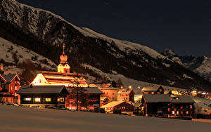 Picture Switzerland Houses Winter Mountains Night Street lights Snow Reckingen Goms Cities