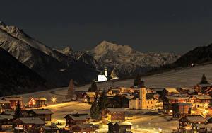 Photo Switzerland Houses Mountains Winter Snow Night Street lights Bergdorf Cities