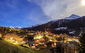 Pictures Switzerland Houses Mountain Night time Munster Goms Cities