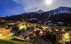Picture Switzerland Mountains Building Night time Munster Goms Cities