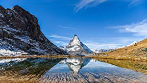 Fondos de escritorio Suiza Montaña Lago Cielo Acantilado