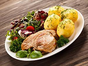 Bilder Die zweite Gerichten Kartoffel Fleischwaren Gemüse Bretter Teller das Essen