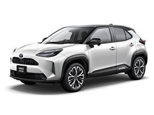 Fotos Toyota Softroader Metallisch Weißer hintergrund Toyota Yaris Cross Hybrid Z, JP-spec, 2020 automobil