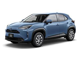 Bilder Toyota Blau Metallisch Crossover Weißer hintergrund Yaris Cross Hybrid X, JP-spec, 2020 Autos