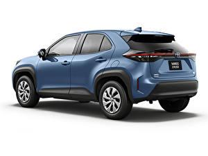 Hintergrundbilder Toyota Softroader Blau Metallisch Weißer hintergrund Yaris Cross Hybrid X, JP-spec, 2020 Autos