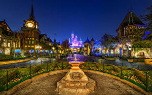 Picture USA Disneyland Parks Building Monuments Clock Castle California Night Street lights Bush Cities