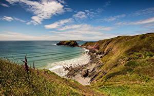 Bilder Vereinigtes Königreich Küste Meer Steine Himmel Wales Wolke Natur