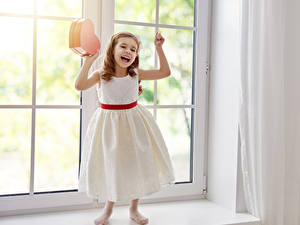 Pictures Valentine's Day Little girls Heart Frock Brown haired Window Children
