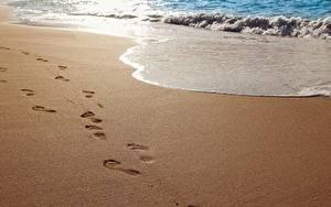 Fotos Wasserwelle Meer Strände Sand Fußabdrücke