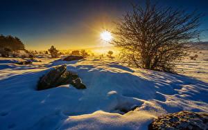 Fotos Winter Sonnenaufgänge und Sonnenuntergänge Landschaftsfotografie Schnee Lichtstrahl Sonne Natur