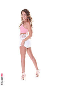 Images iStripper Alexis Adams White background Pose Staring Hands Skirt Legs High heels young woman