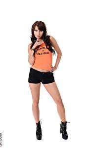 Fotos iStripper Yarina A Weißer hintergrund Brünette Pose Hand Shorts Unterhemd Bein Boots junge frau