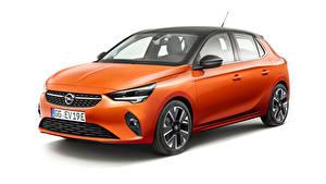 Bilder Opel Weißer hintergrund Orange 2019-20 Corsa-e Autos