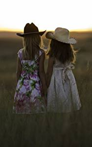 Images Sunrises and sunsets Two Little girls Hat Grass Children