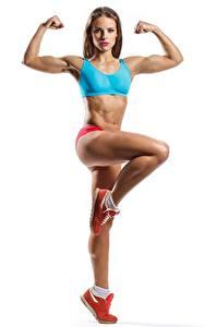 Hintergrundbilder Fitness Posiert Bein Hand Starren Weißer hintergrund sportliches Mädchens