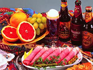 Bilder Schinken Zitrusfrüchte Weintraube Bier Grapefruit Weinglas Flaschen