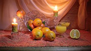 Bilder Stillleben Zitrusfrüchte Apfelsine Kerzen Lebensmittel