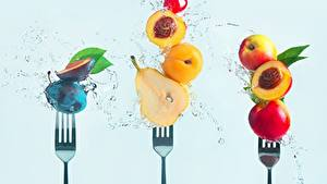 Photo Pears Plums Peaches Apricot Fork Water splash Colored background