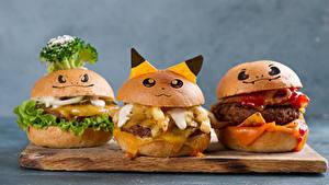 Bilder Fast food Burger Brötchen Grauer Hintergrund Schneidebrett Design Drei 3