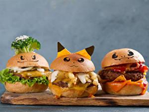 Bilder Fast food Burger Brötchen Grauer Hintergrund Schneidebrett Design Drei 3 Lebensmittel