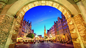 Picture Gdańsk Poland Houses Evening Street Street lights Arch Cities