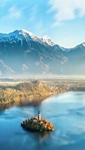 Fotos Slowenien Morgendämmerung und Sonnenuntergang Gebirge Insel Landschaftsfotografie Nebel Von oben Lake Bled