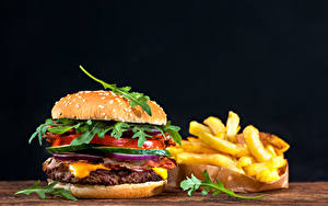 Hintergrundbilder Fast food Burger Brötchen Fritten Gemüse Schwarzer Hintergrund