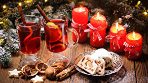 Bilder Neujahr Keks Schalenobst Zimt Kerzen Getränk Kekse Bretter Trinkglas
