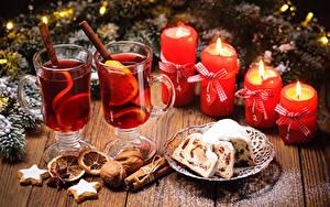 Bilder Neujahr Keks Schalenobst Zimt Kerzen Getränk Kekse Bretter Trinkglas das Essen
