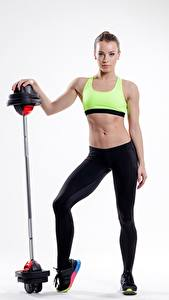 Pictures Fitness Barbell Gray background Girls Sport