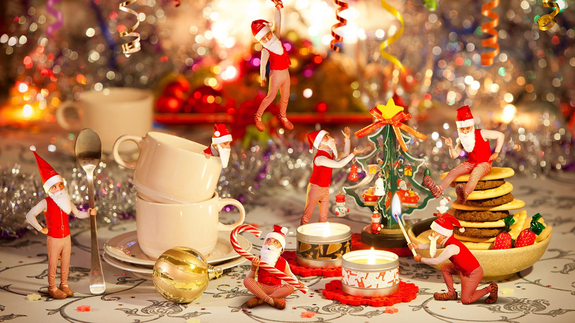 Fotos Neujahr Mütze Weihnachtsmann Flamme Tasse sitzt Kerzen Feiertage 1920x1080 Feuer sitzen Sitzend