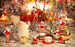 Hintergrundbilder Neujahr Kerzen Feuer Feiertage Weihnachtsmann Mütze Sitzend Tasse