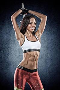 Fotos Fitness Braunhaarige Lächeln Muskeln Bauch Mädchens Sport