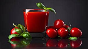 Pictures Juice Tomatoes Gray background Highball glass Drops Leaf