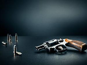 Bilder Pistolen Patrone Grauer Hintergrund Revolver Heer