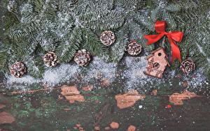 Bilder Neujahr Bretter Ast Zapfen Schnee Schleife