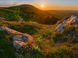 Pictures Russia Crimea Autumn Sunrises and sunsets Stones Hill Grass Sun Nature