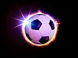 Bilder Fußball Schwarzer Hintergrund Ball Lichtstrahl Sport