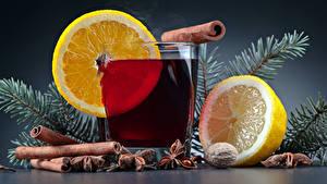 Fotos Neujahr Getränke Zitrone Zimt Sternanis Trinkglas Ast Lebensmittel